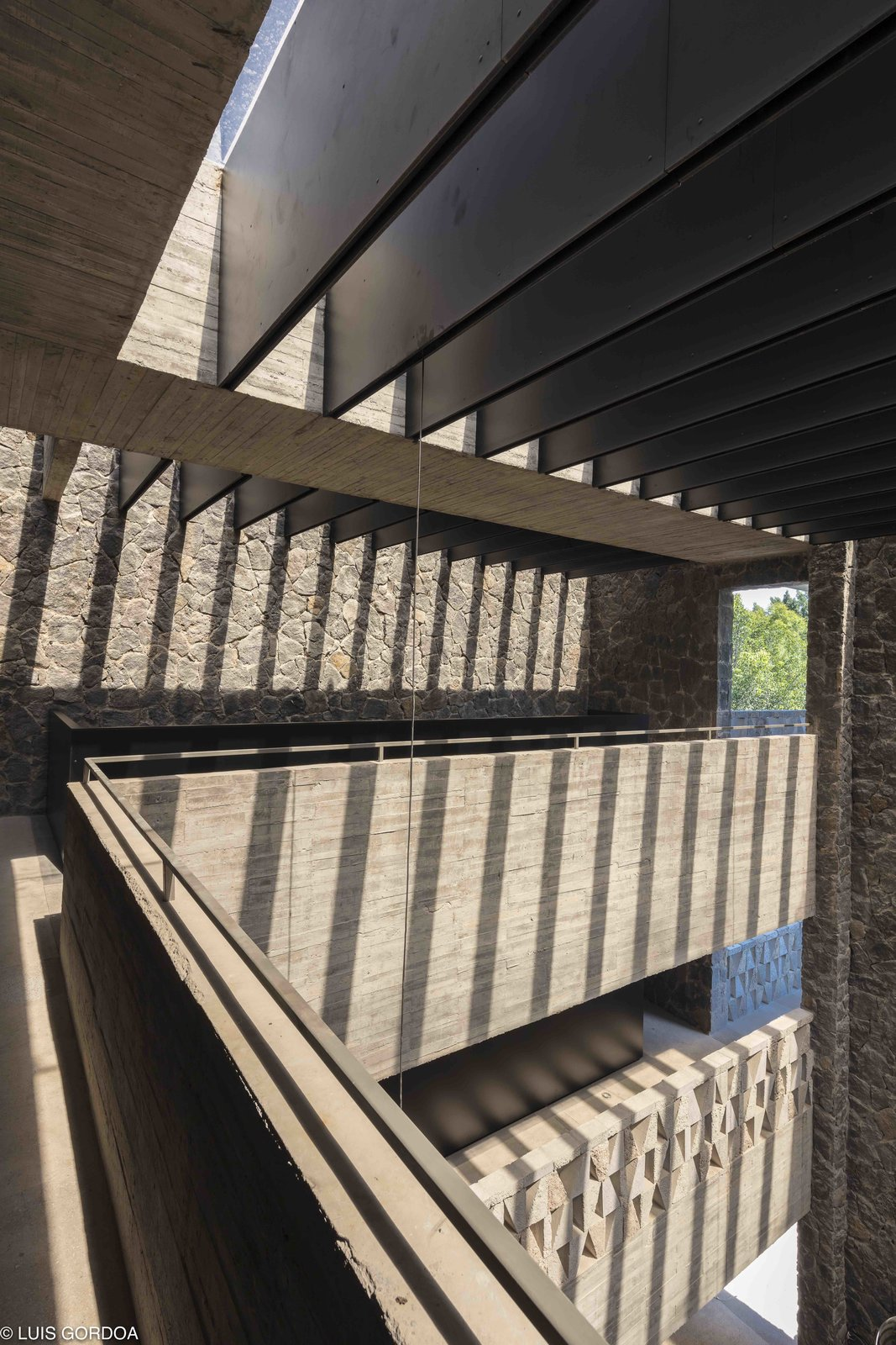 To take full advantage of Jiutepec's year-round warm weather, plenty of open-air patios are incorporated into the design. Tagged: Hallway.  Photo 7 of 12 in A New Hotel in Morelos Combines Local Mexican Elements With Brutalist Architecture