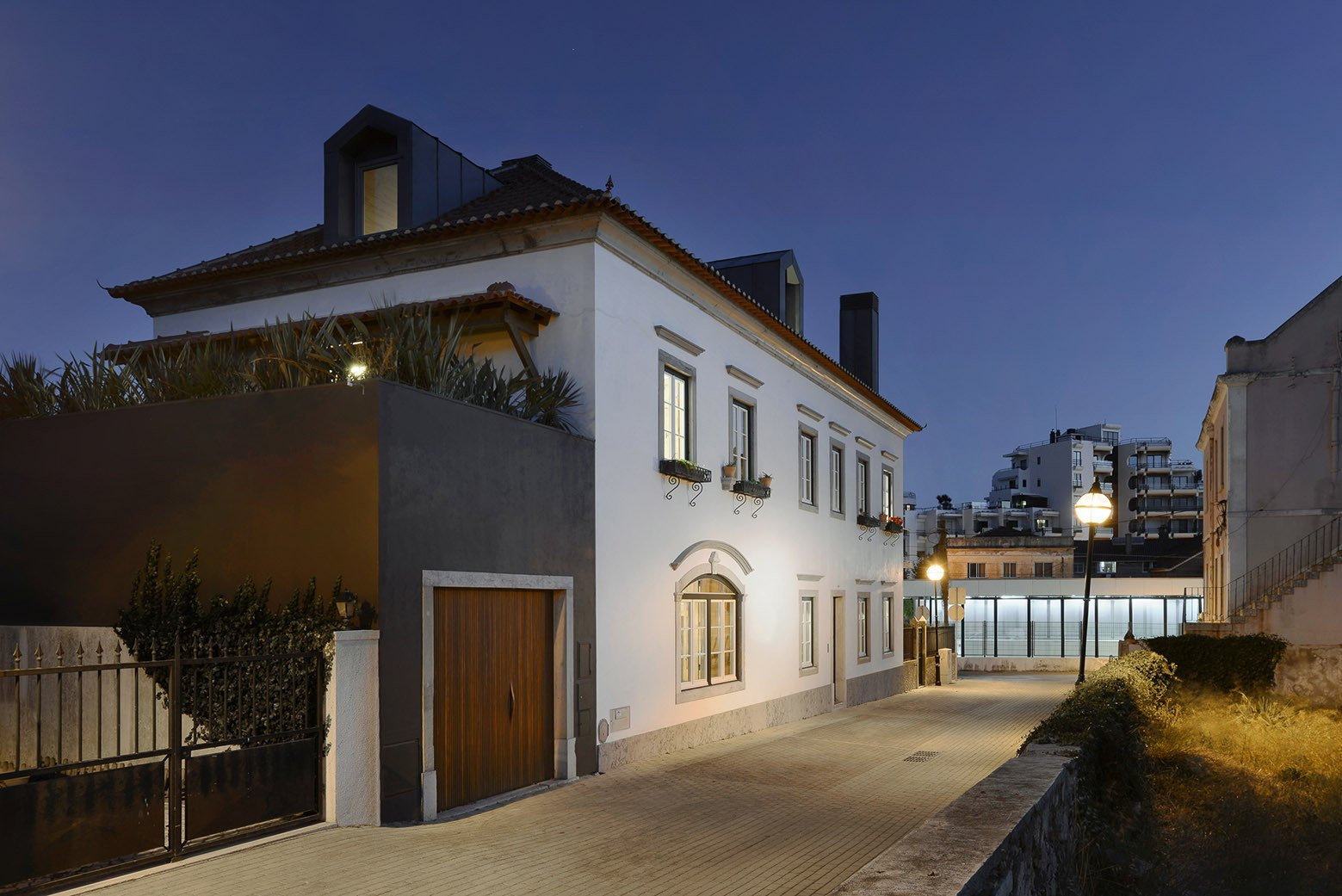 Tagged: Outdoor, Front Yard, Metal Fences, Wall, Hardscapes, and Walkways.  Photo 2 of 16 in An Architect Renovates His 1920s Home in Portugal, While Preserving the Exterior Shell