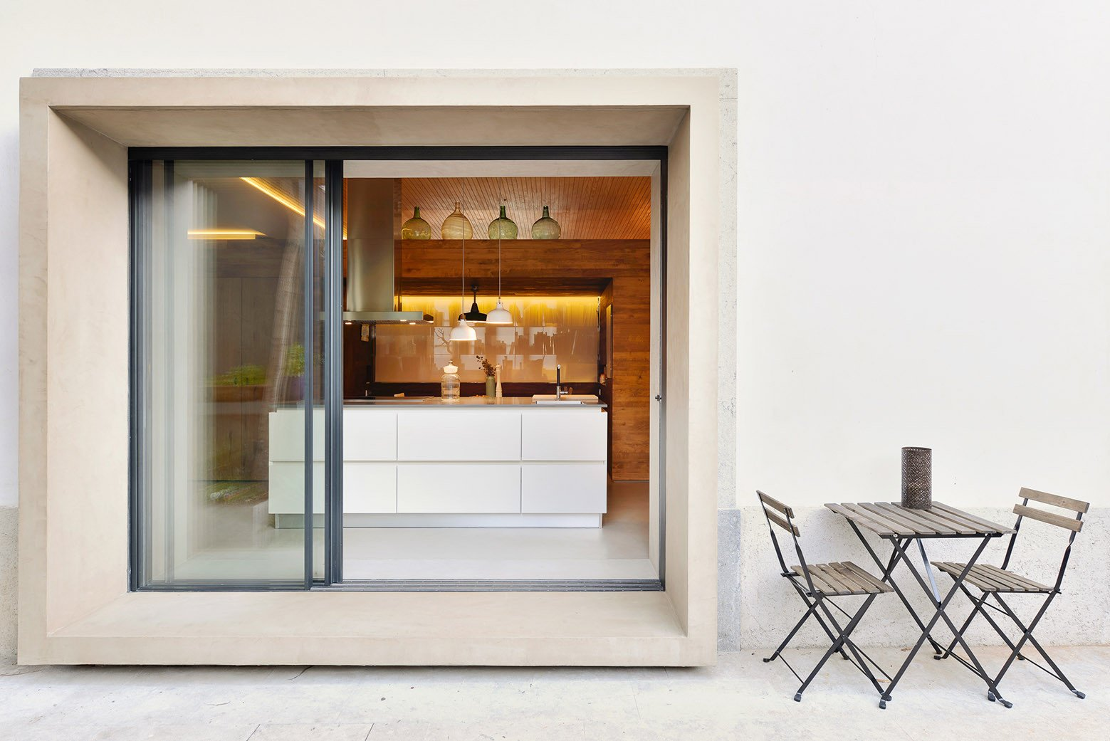 Tagged: Doors, Exterior, Metal, and Sliding Door Type.  Photo 7 of 16 in An Architect Renovates His 1920s Home in Portugal, While Preserving the Exterior Shell