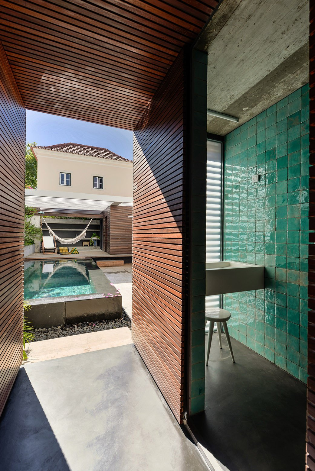 Tagged: Outdoor, Decking Patio, Porch, Deck, Small Pools, Tubs, Shower, and Back Yard.  Photo 9 of 16 in An Architect Renovates His 1920s Home in Portugal, While Preserving the Exterior Shell