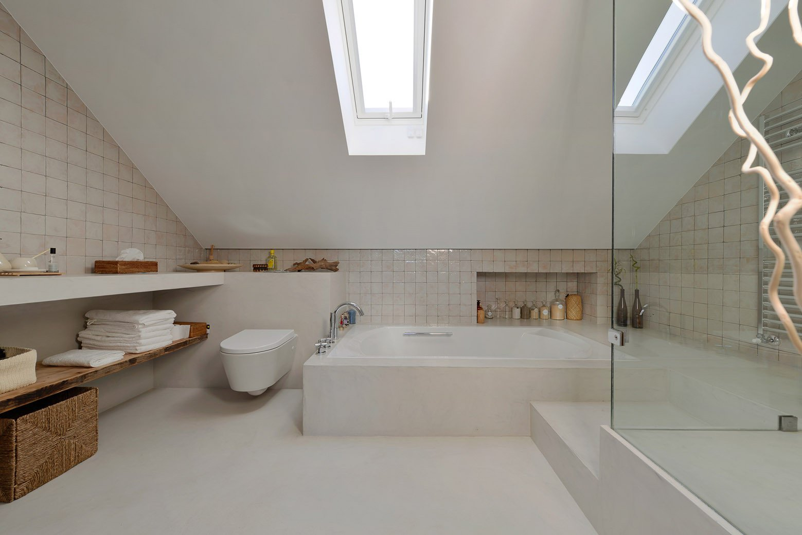 Tagged: Bath Room, Concrete Floor, Drop In Tub, Ceramic Tile Wall, and One Piece Toilet.  Photo 14 of 16 in An Architect Renovates His 1920s Home in Portugal, While Preserving the Exterior Shell