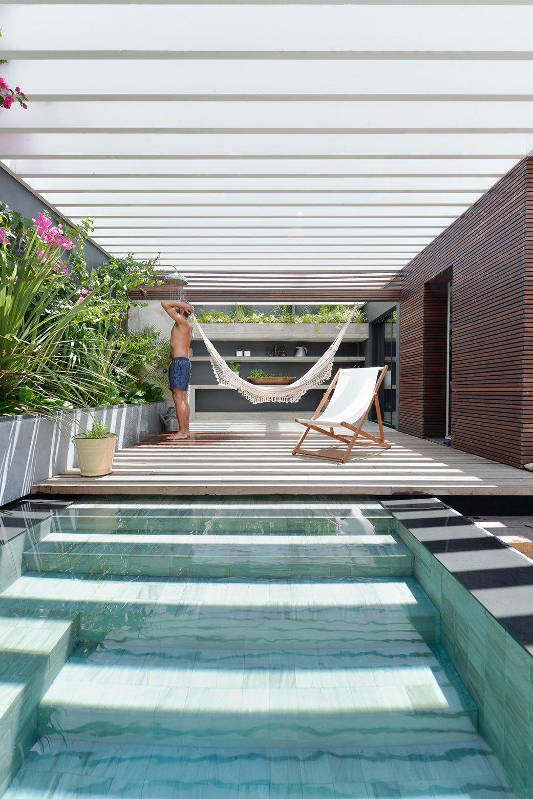 Tagged: Outdoor, Back Yard, Small Pools, Tubs, Shower, and Gardens.  Photo 16 of 16 in An Architect Renovates His 1920s Home in Portugal, While Preserving the Exterior Shell