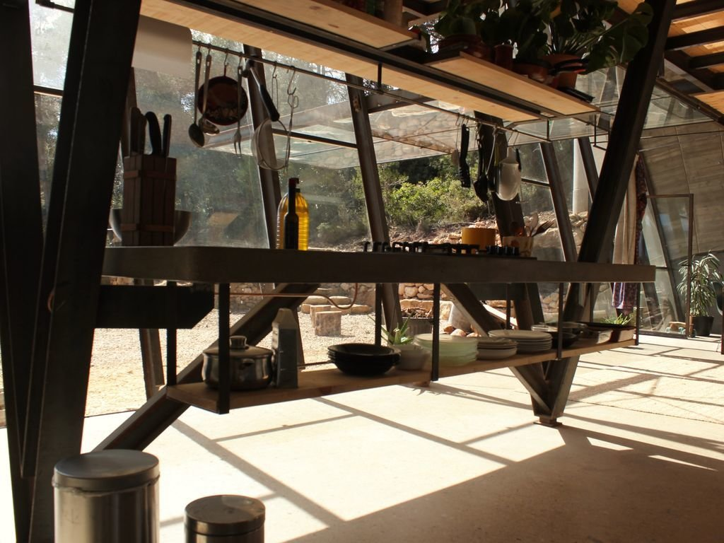 Tagged: Kitchen, Concrete Counter, and Range.  Photo 7 of 8 in Stay in a Domed, Glass-Front Vacation Home in a Spanish Forest