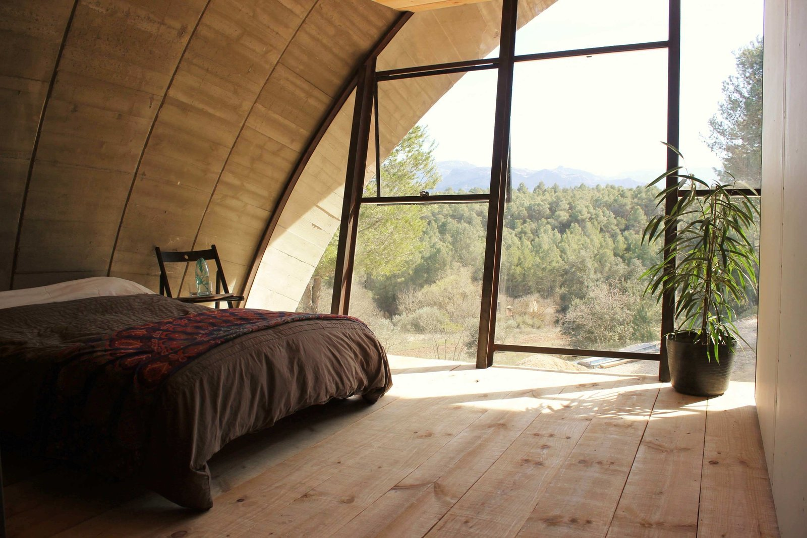 Tagged: Bedroom, Chair, Bed, and Light Hardwood Floor.  Photo 5 of 8 in Stay in a Domed, Glass-Front Vacation Home in a Spanish Forest