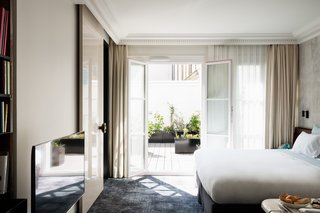 12 Modern Hotels in Historic Buildings Around the World - Photo 8 of 24 - The interiors of Les Bains in Paris, France