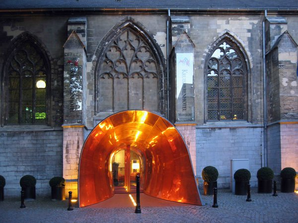 """This renovated 15th century monastery of the """"Crutched Friars"""" is now the 60-room Kruisherenhotel Maastricht – a luxurious contemporary hotel where guests can check-in or dine at a site that was the monastery's old church."""