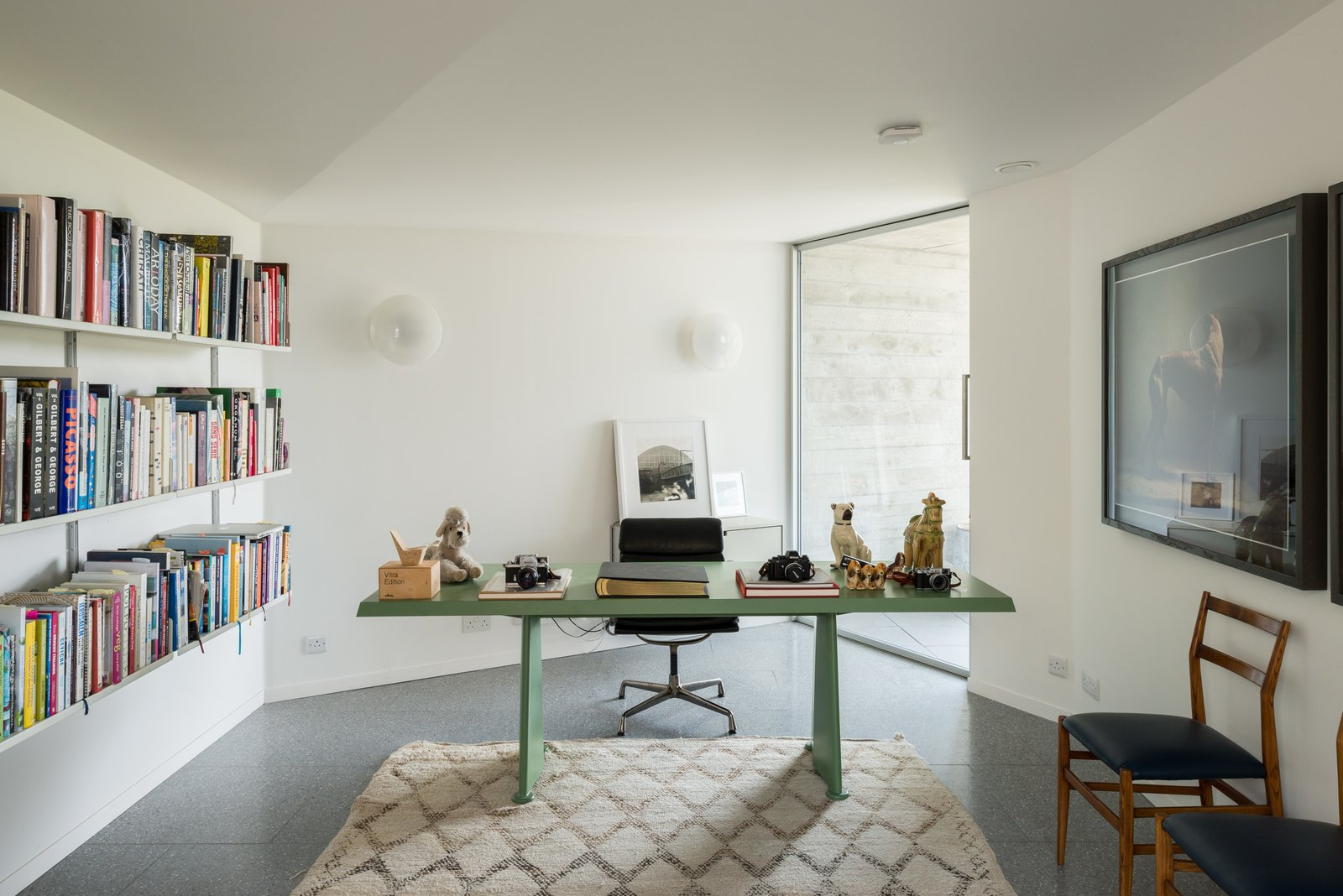 Tagged: Office, Shelves, Library, Chair, Study, Desk, and Terrazzo Floor.  Photo 8 of 12 in Explore a Prefabricated House For Sale in England That's Clad With Cor-Ten Steel