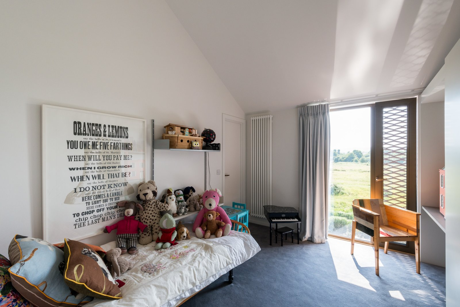 Tagged: Kids Room, Bed, Bedroom, Shelves, Chair, Toddler Age, Neutral Gender, and Carpet Floor.  Photo 11 of 12 in Explore a Prefabricated House For Sale in England That's Clad With Cor-Ten Steel