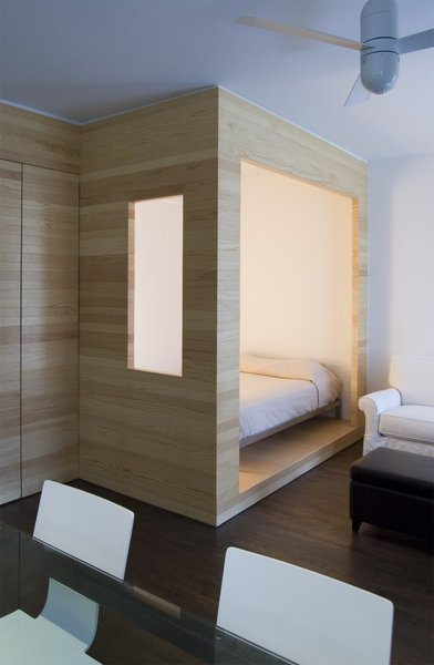 Framework Architecture created a partially enclosed sleeping nook in this tiny Brooklyn studio apartment, which snuggly fits a full-sized bed.