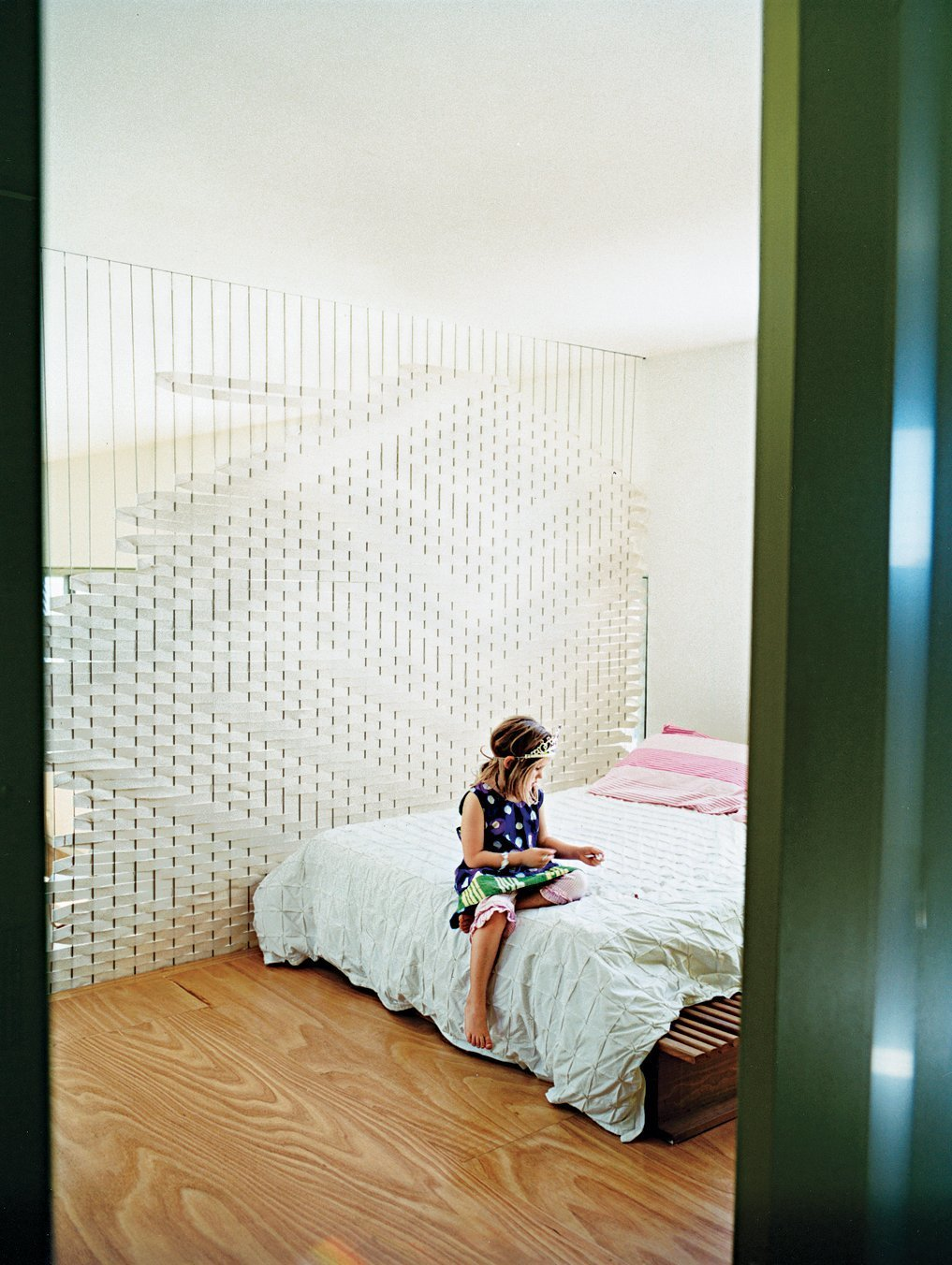 Architect-sculptor double act Cat Macleod and Michael Bellemo's Melbourne split-level home has a loft bedroom with a clever divider Macleod created out of white weaved engineering felt.
