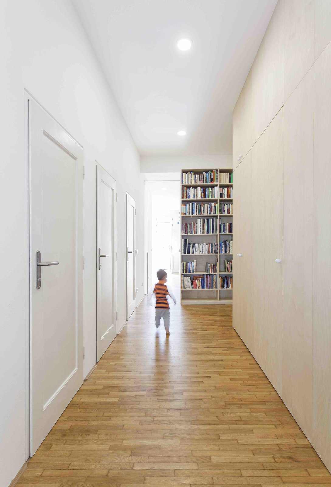 Tagged: Hallway and Medium Hardwood Floor. A Family Apartment in Prague That's Filled With Clever Storage Solutions and Built-In Nooks - Photo 9 of 13