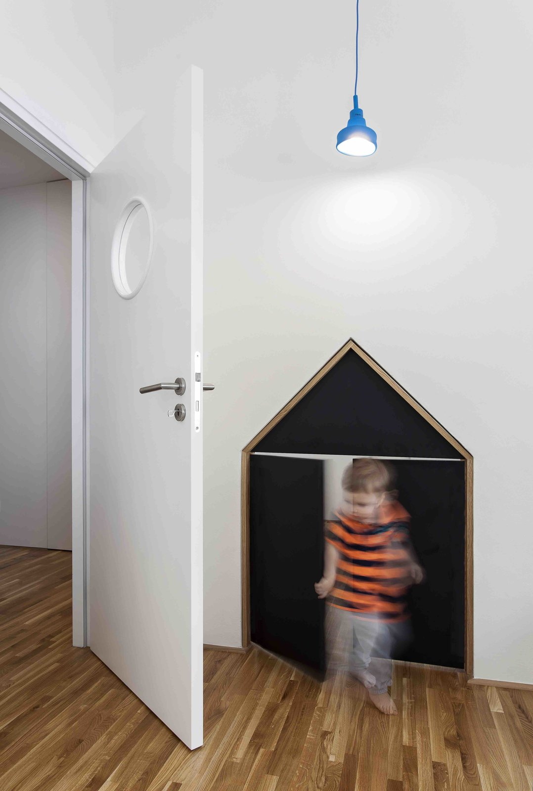 Tagged: Kids Room, Medium Hardwood Floor, and Toddler Age.  Photo 11 of 13 in A Family Apartment in Prague That's Filled With Clever Storage Solutions and Built-In Nooks