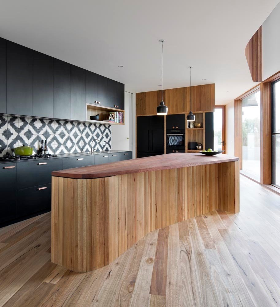 Eye-catching tiled splashback from Popham Design. Tagged: Kitchen, Wood Cabinet, Light Hardwood Floor, Pendant Lighting, and Wood Counter.  Photo 2 of 10 in How to Design a Kitchen That's Ideal For Entertaining—and Shop Our Picks