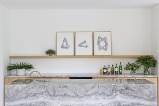 6 Home Wet Bars That Will Inspire You to Up Your Entertaining Game - Photo 6 of 6 - In Apartment G in downtown Singapore, Takenouchi Webb designed a Fior De Pesca marble bar counter with an integrated sink across from the dining table.