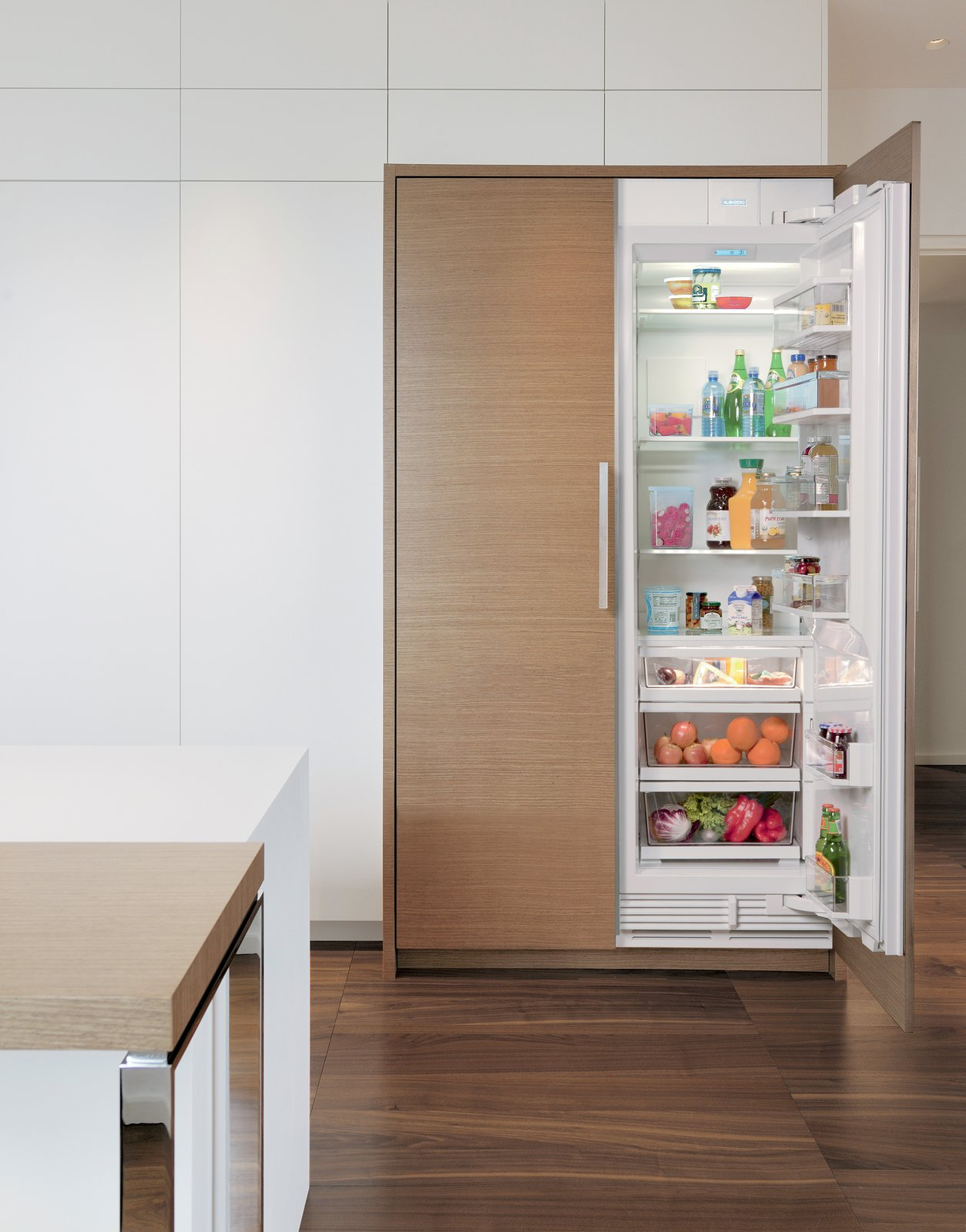 Integrated built-in regrigeration unit with smart-touch controls.  Photo 6 of 10 in How to Design a Kitchen That's Ideal For Entertaining—and Shop Our Picks