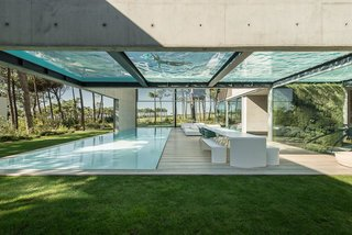 A Pool With a Glass Bottom Hovers Over Another at a House in the Portuguese Riviera