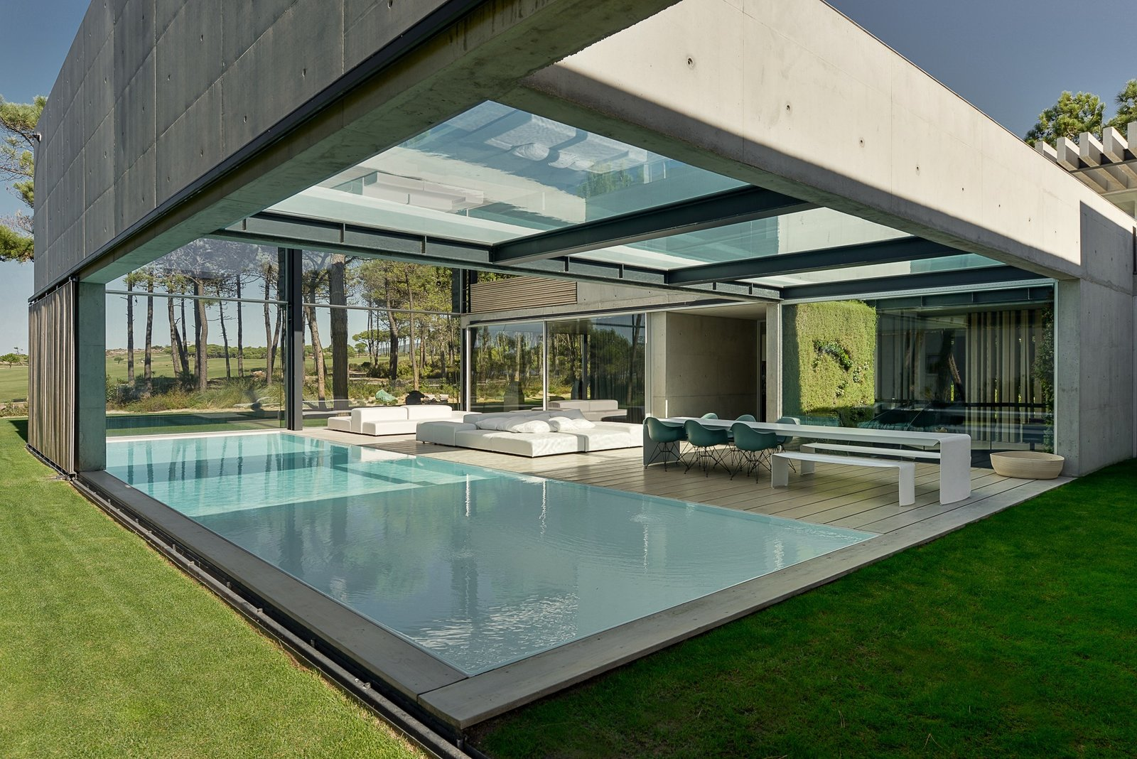 Tagged: Outdoor, Large Pool, Back Yard, Swimming Pool, Grass, Decking Patio, Porch, Deck, Large Patio, Porch, Deck, Wood Patio, Porch, Deck, and Trees. A Pool With a Glass Bottom Hovers Over Another at a House in the Portuguese Riviera - Photo 3 of 13