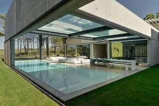 A Pool With a Glass Bottom Hovers Over Another at a House in the Portuguese Riviera - Photo 2 of 12 -