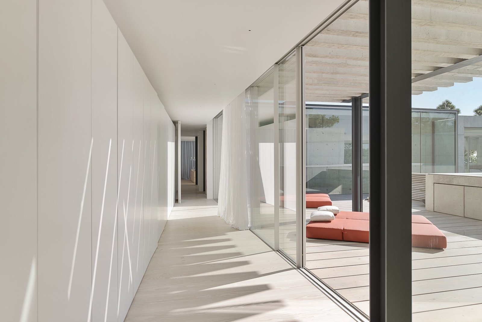 Tagged: Hallway, Hallway, and Light Hardwood Floor.  Photo 4 of 13 in A Pool With a Glass Bottom Hovers Over Another at a House in the Portuguese Riviera