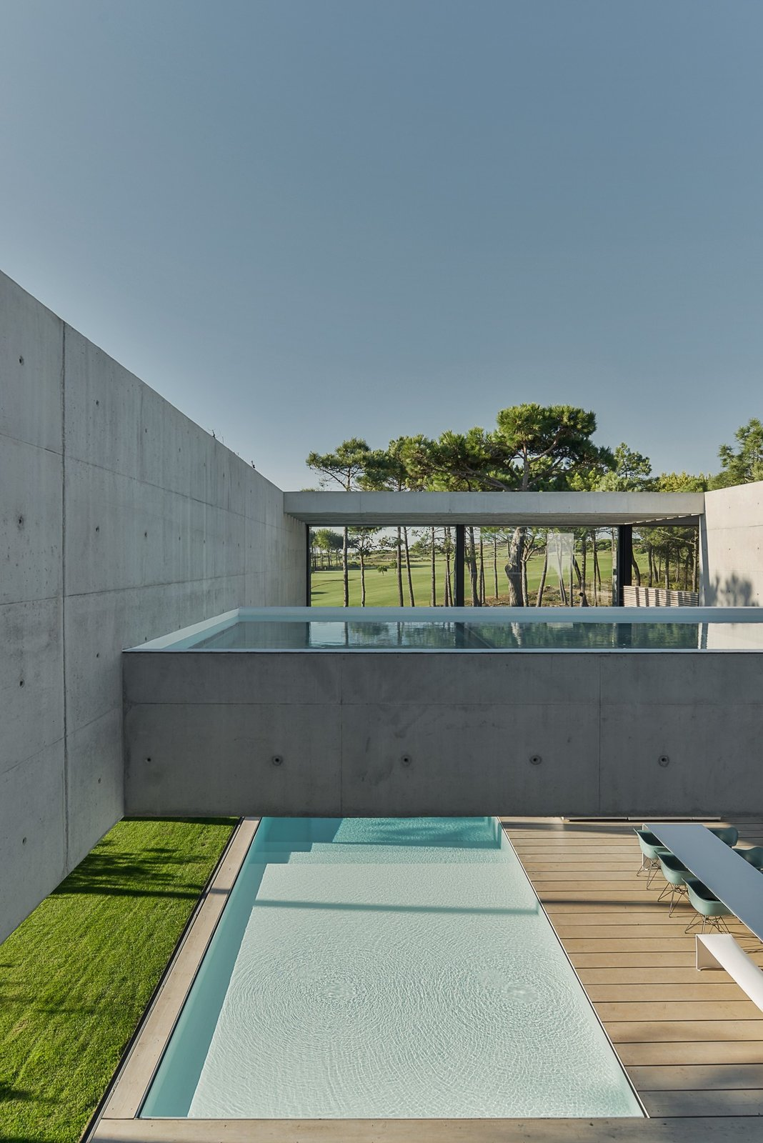 Tagged: Outdoor, Back Yard, Trees, Grass, Small Pools, Tubs, Shower, Wood Patio, Porch, Deck, and Concrete Pools, Tubs, Shower.  Photo 7 of 13 in A Pool With a Glass Bottom Hovers Over Another at a House in the Portuguese Riviera