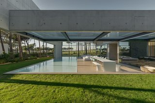 A Pool With a Glass Bottom Hovers Over Another at a House in the Portuguese Riviera - Photo 12 of 12 -