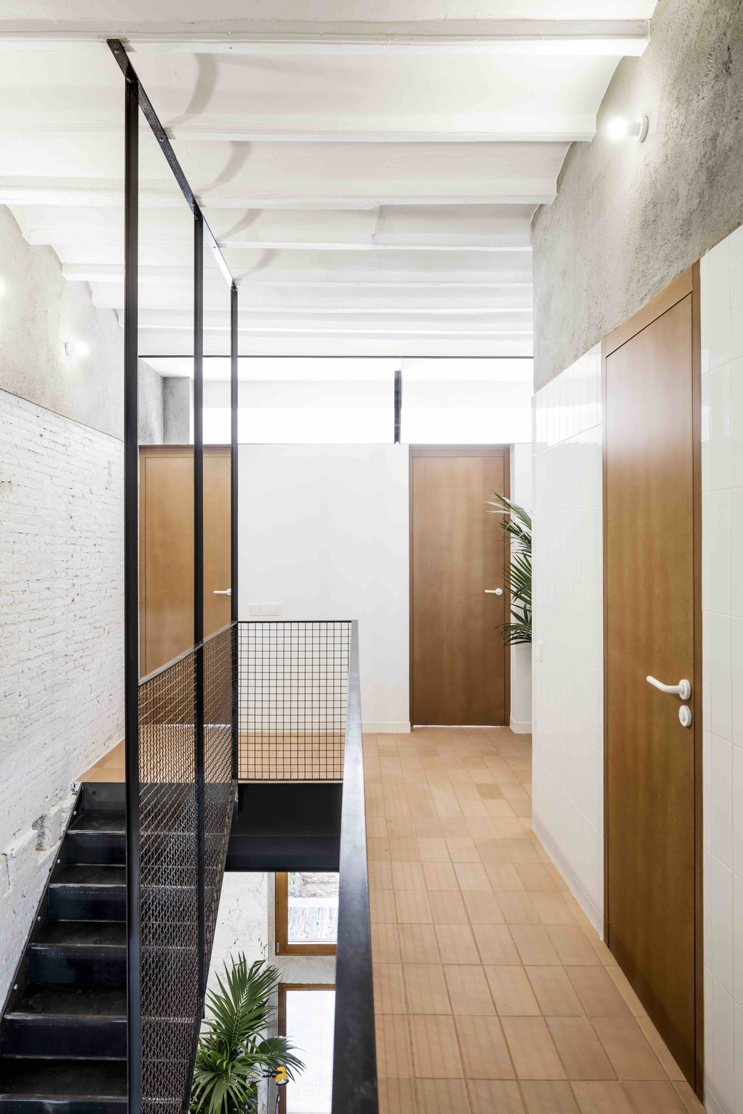 Tagged: Staircase, Metal Railing, and Metal Tread.  Photo 6 of 13 in This Double-Height Apartment in   Barcelona Features Historic Details and a Floating Staircase