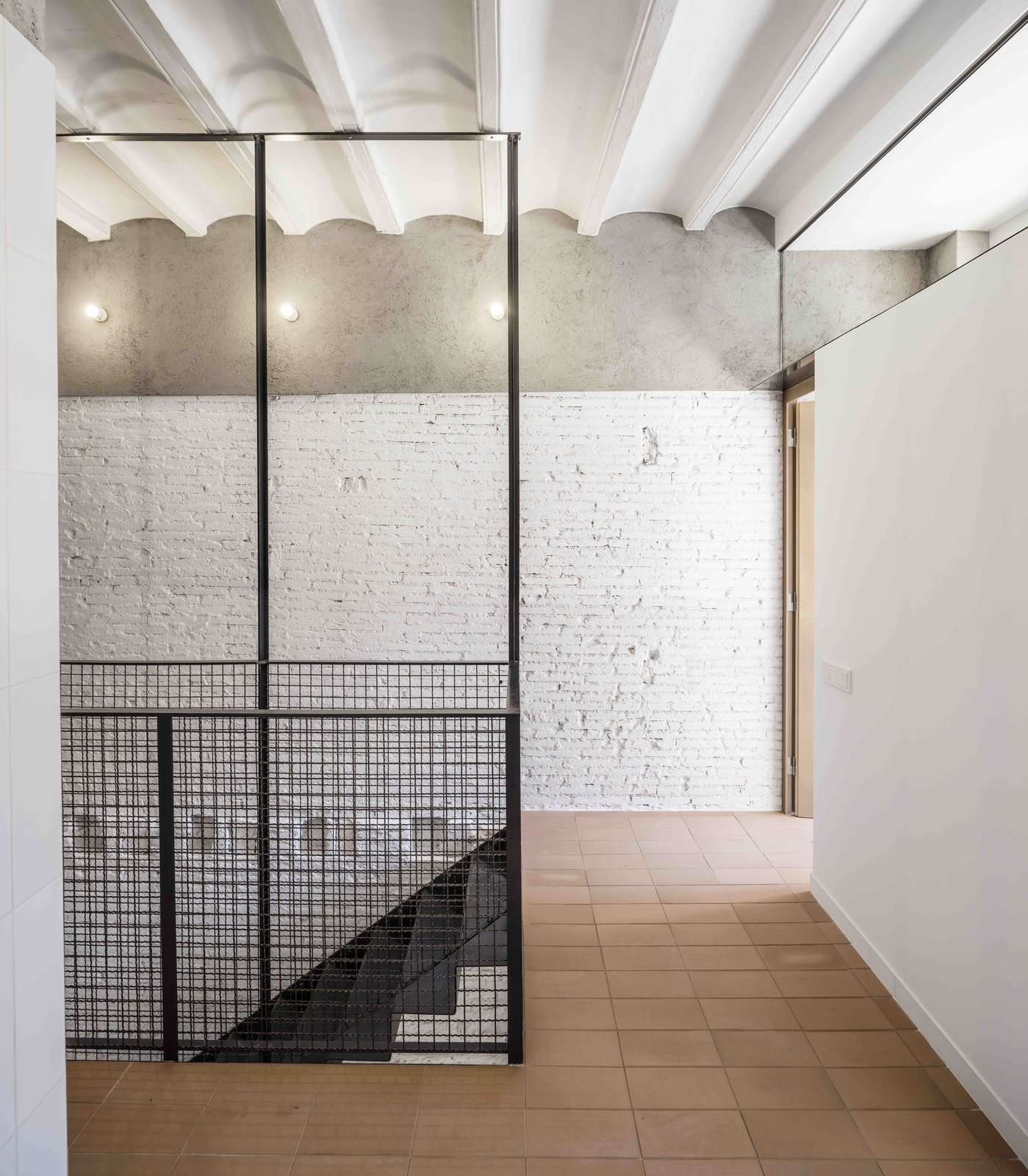 Tagged: Hallway.  Photo 7 of 13 in This Double-Height Apartment in   Barcelona Features Historic Details and a Floating Staircase