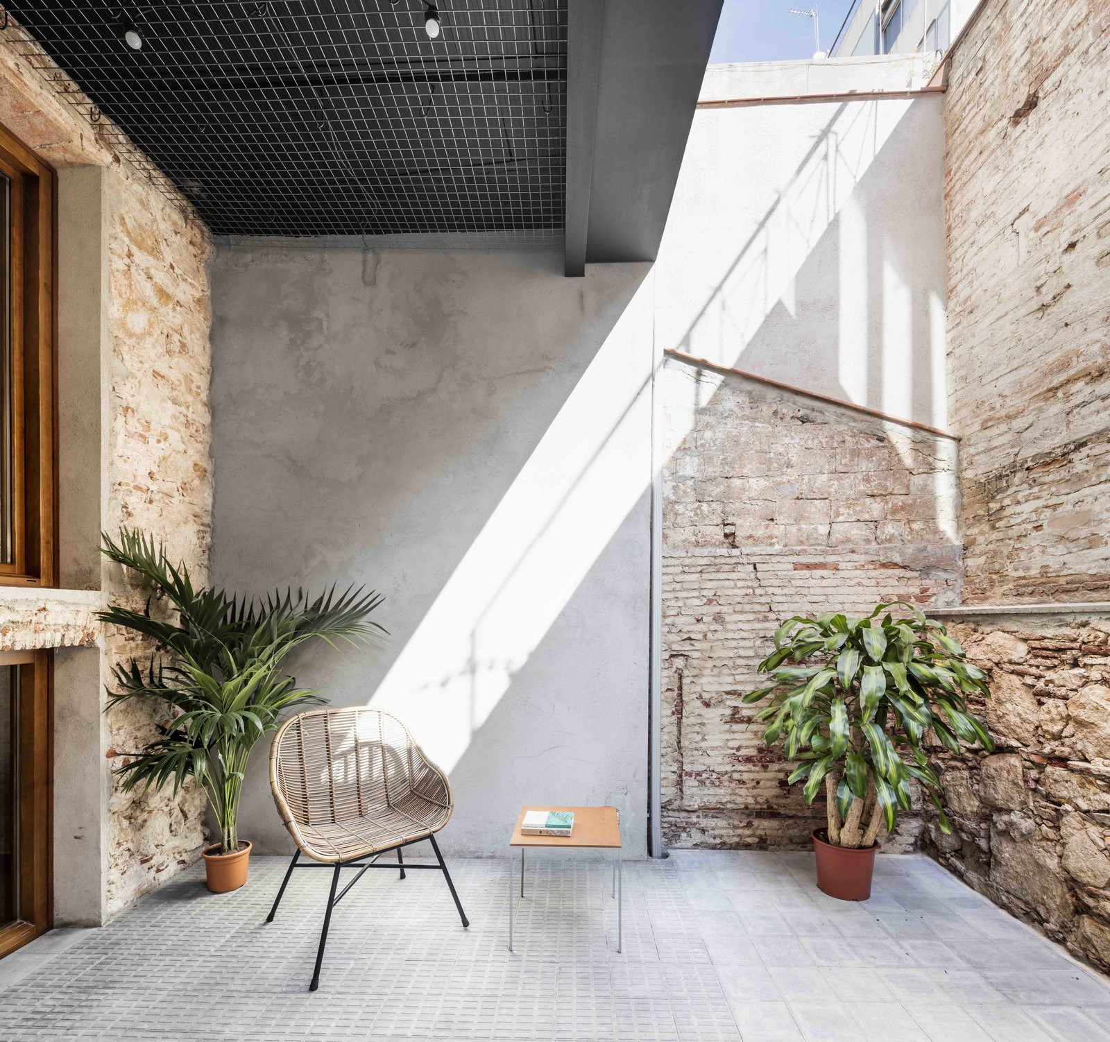Tagged: Outdoor, Tile Patio, Porch, Deck, Back Yard, and Small Patio, Porch, Deck.  Photo 9 of 13 in This Double-Height Apartment in   Barcelona Features Historic Details and a Floating Staircase