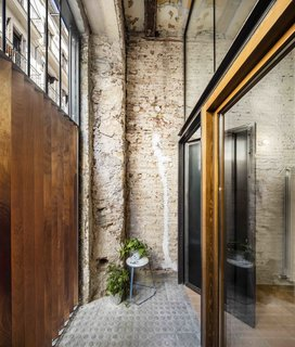 This Double-Height Apartment in   Barcelona Features Historic Details and a Floating Staircase - Photo 11 of 12 -