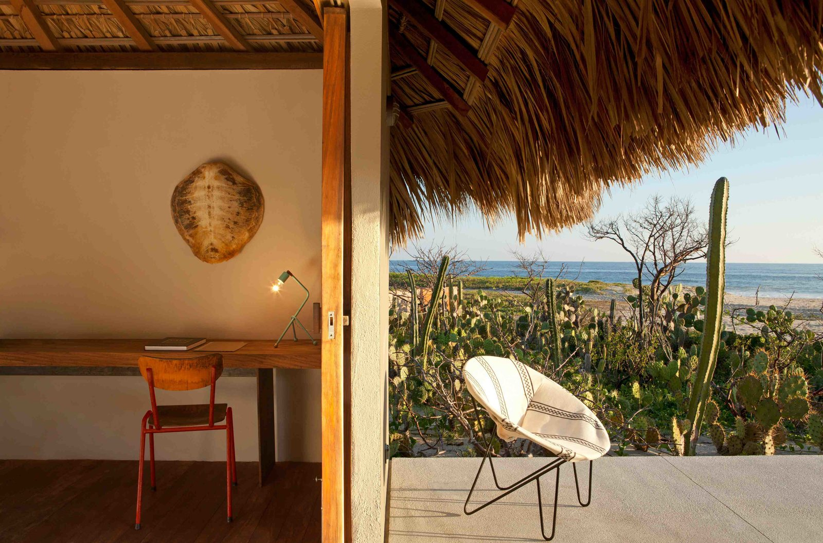 Architect Federico Rivera Rio updated traditional Oaxacan beach huts with palapa roofs, transforming it into stylish, minimalist bungalow hotel rooms with stucco walls, wooden floors and polished concrete bathrooms.