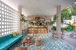 7 Modern Hotels in Mexico You Have to Visit - Photo 2 of 7 - Inspired by midcentury architecture in Miami, this hotel located within a yoga retreat community center known as Holistika Tulum is a retro jungle oasis with cool custom-made floor tiles, rattan chairs, and a calming aquamarine color scheme.