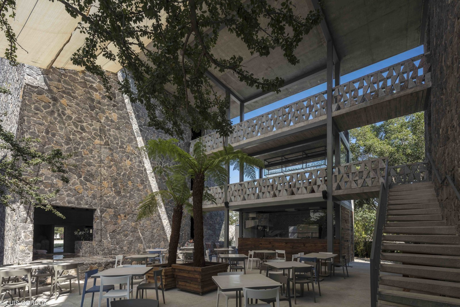 Hotel Huayacan, designed by Mexican architect Alfredo Cano of T3arc is a 40-room hotel that combines brutalist forms with robust local stone.