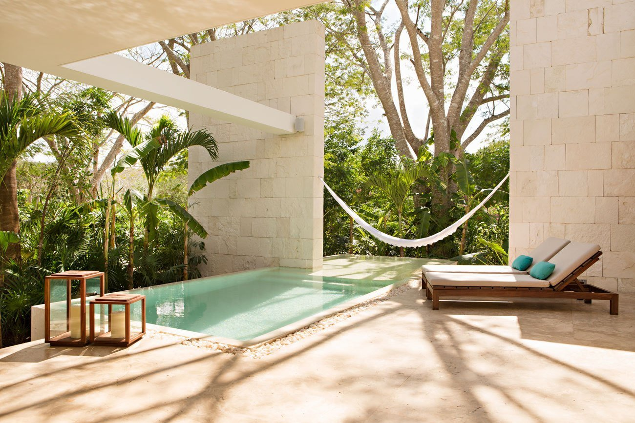 A 19th Century estate in the Yucatán jungle was given new life as a modern Mexican hotel with villa-style abodes with bath tubs of polished rock and casitas with their own pool and outdoor showers.