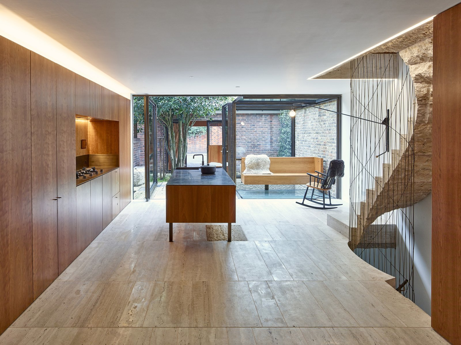 In this Edwardian London house, the colors and textures of brick that forms the perimeter of a outdoor courtyard, can be enjoyed through floor-to-ceiling windows in the kitchen. 10 Modern Structures That Use Brick in Interesting Ways - Photo 6 of 10