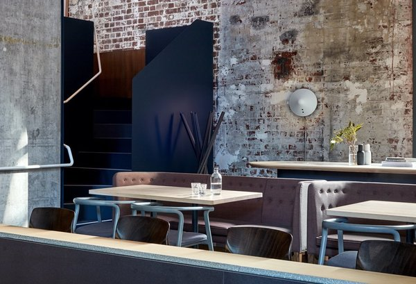10 Modern Structures That Use Brick in Interesting Ways - Photo 10 of 10 - When this old power station in Melbourne was restored and transformed into a chic, six-level restaurant, the raw brick and concrete structure of the original building was preserved. The weathered look of the brick walls serve as a dramatic backdrop to the fashionable, contemporary furniture that inhabits the space.