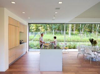 9 Eco-Friendly Homes With Smart, Sustainable Features - Photo 7 of 9 - This family beach home in Montauk in the Hamptons is equipped with sustainable features such as a prefabricated foundation, a geothermal heating and cooling system buried below ground, and non-toxic finishes.