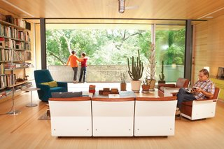 10 Timeless Midcentury-Modern Homes - Photo 3 of 10 - Designed by architect Jonathan Bowman in 1957, this remodeled ranch house in Austin, Texas, stays true to its midcentury heritage with a modular 620 Chair Program from Dieter Rams, Artemide's classic Tolomeo floor lamp, and a Portofino Bergère chair designed by Rodolfo Dordoni for Minotti.