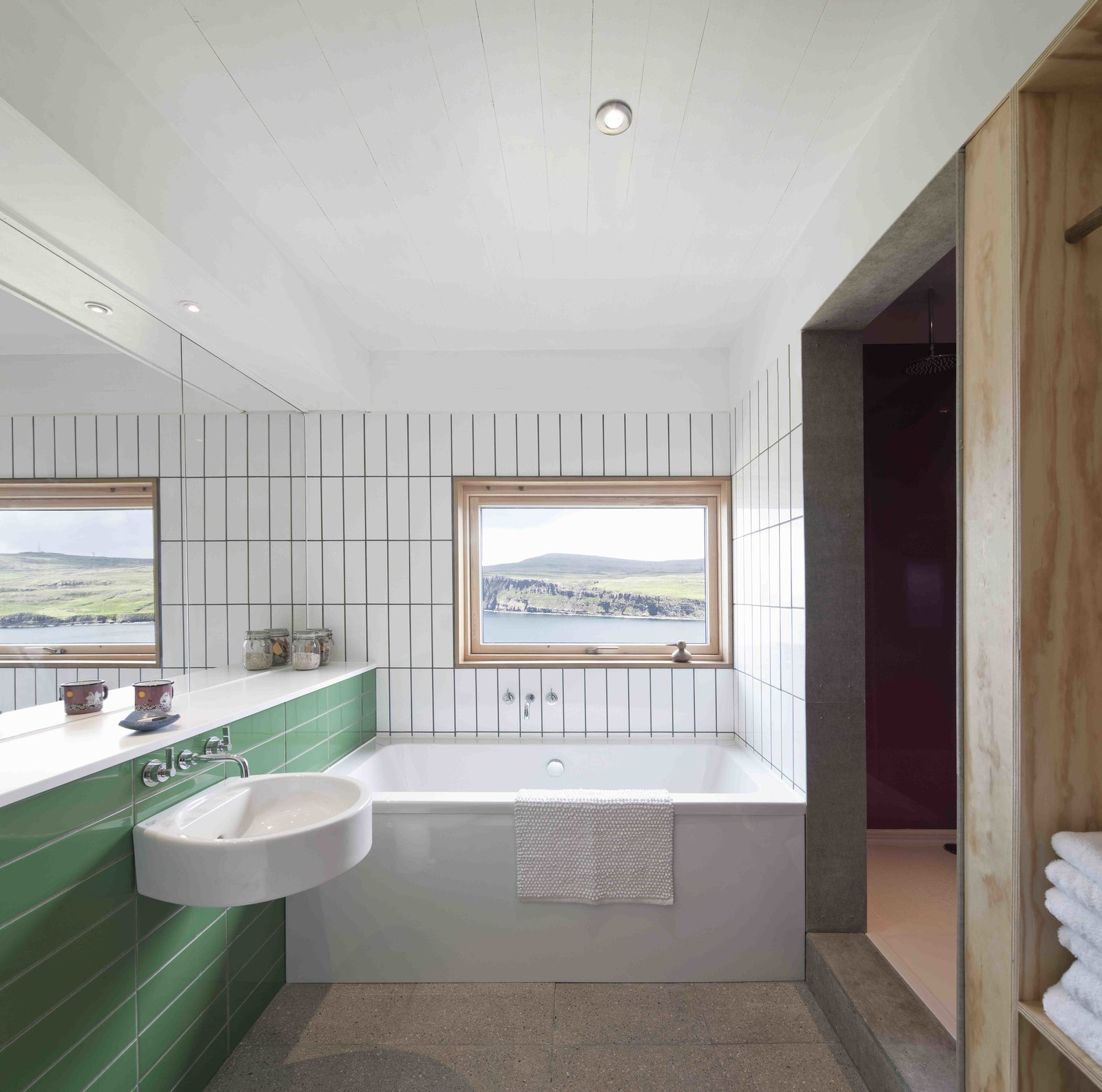 Tagged: Bath Room, Ceramic Tile Wall, Alcove Tub, Concrete Floor, Ceiling Lighting, and Corner Shower.  Photo 5 of 11 in Stay in a Modern Tin Cottage on Scotland's Isle of Skye