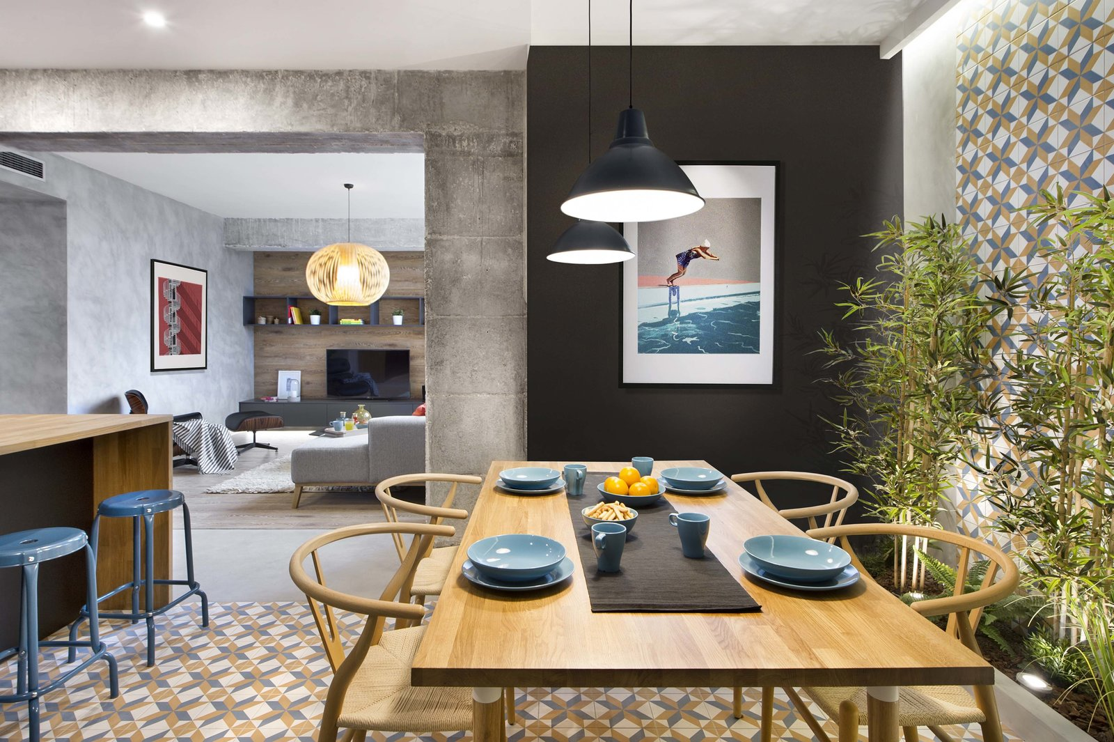 Tagged: Dining, Chair, Table, Pendant, Ceramic Tile, and Stools.  Best Dining Pendant Stools Photos from In This Compact Barcelona Apartment, Space Is Maximized With Smart Material Choices