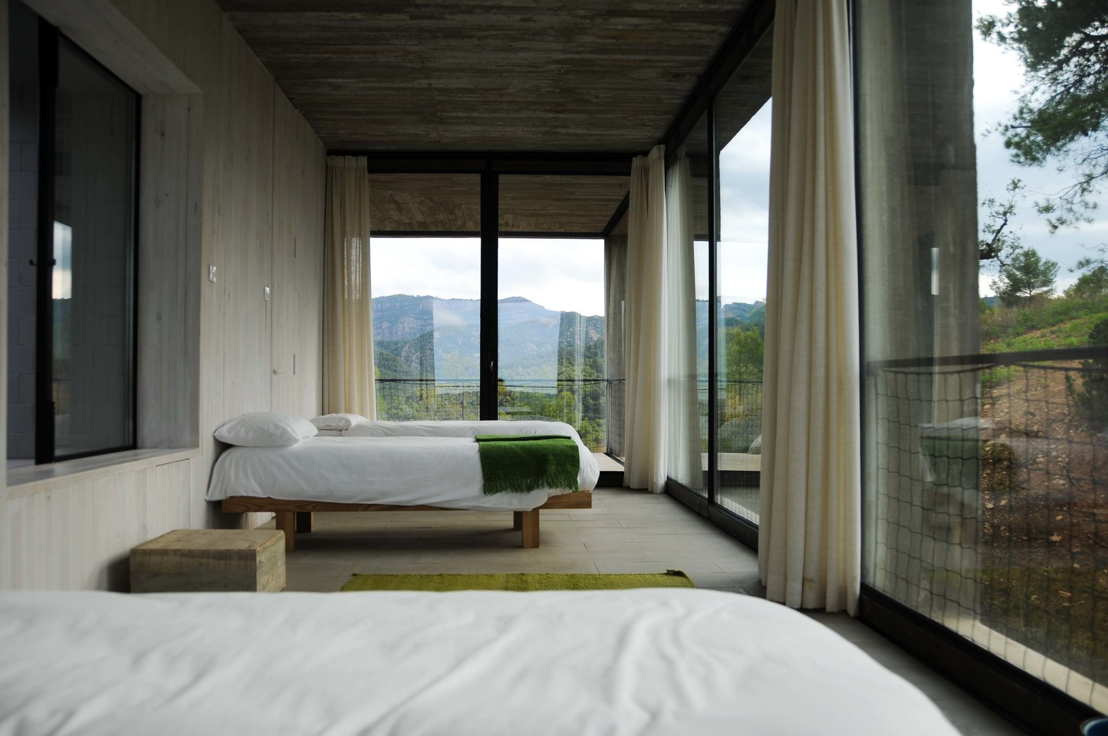 Tagged: Bedroom, Bed, and Concrete Floor.  Photo 13 of 18 in Stacked Concrete Squares Make Up This Incredible Vacation Home in Aragon, Spain