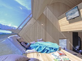 Stay in a Tiny Shingled Cabin in Austria That Resembles a Bird-Like UFO - Photo 9 of 11 -