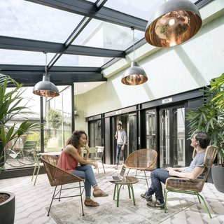 8 Modern Solariums and Sun-Drenched Spaces - Photo 7 of 8 - On the sixth floor of Airbnb's Paris office is a bright, plant-filled solarium where staff can relax and socialize. Designed by Airbnb in collaboration with STUDIOS Architecture, the space has all the relaxed breeziness of a Parisian attic loft.