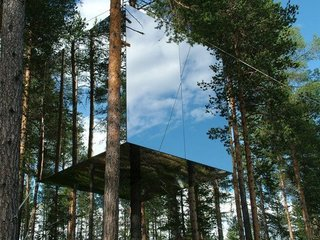 8 Structures and Spaces That Use Mirrored or Reflective Surfaces in Interesting Ways - Photo 6 of 8 - Six designers got together to create the 13-by-13-foot Mirrorcube in Treehotel in Harad, Sweden. The structure is made up of a reflective glass cube that's built around the trunk of a pine tree, which blends beautifully into the surrounding forest.
