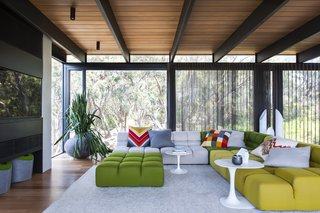 11 Amazing Australian Homes - Photo 2 of 11 - This house in the Mornington Peninsula in the south of Melbourne is filled with materials like natural stone, steel, and cedar, which serve as perfect backdrops for the bold colors and edgy midcentury furniture that firm SJB employed in the space.