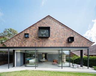 11 Amazing Australian Homes - Photo 6 of 11 - When renovating this 1930s Arts and Crafts-style bungalow in Sydney, TRIBE Studio Architects used vertically and horizontally stacked bricks in three different shades to create an interesting, modern facade at the garden-facing rear of the property.