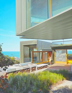 11 Amazing Australian Homes - Photo 7 of 11 - Sited along the Great Ocean Road, this contemporary home in the village of Fairhaven was designed by architect John Wardle. Surrounded by Eucalyptus trees and facing the sea, the house's kitchen leads to an outdoor deck and BBQ area that's perfect for post-surf dinners.