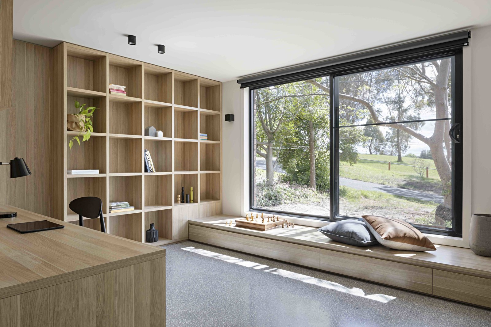 Tagged: Office, Library, Study, Chair, Storage, Shelves, Desk, Bookcase, and Lamps.  Photo 8 of 17 in A Remodel Turns a Dark and Choppy House in Melbourne Into a Bright, Flexible Family Home