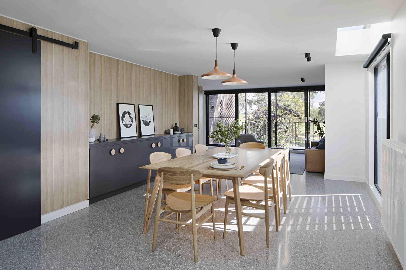 Tagged: Dining Room, Table, Chair, Storage, Pendant Lighting, and Ceiling Lighting.  Photo 16 of 17 in A Remodel Turns a Dark and Choppy House in Melbourne Into a Bright, Flexible Family Home