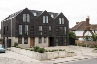6 Best Dwell UK Apartments - Photo 2 of 7 - Located on the site of demolished old bungalows, Haddo Yard in Whitstable now consists of seven newly built apartments developed by Arrant Land and designed by celebrated UK practice Denizen Works. The building's facade has dark brick gables that echo the black timber sea fronts of fishing huts found in this part of Kent.
