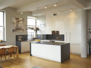 Experience New York City's Eclectic Side at One of These Modern Short-Term Rentals - Photo 7 of 11 - Fitted with 11 massive windows that overlook both Brooklyn and Manhattan, this three-bedroom loft has a fully-equipped gourmet kitchen, which makes it a great choice if you're planning on doing lots of cooking and eating in.